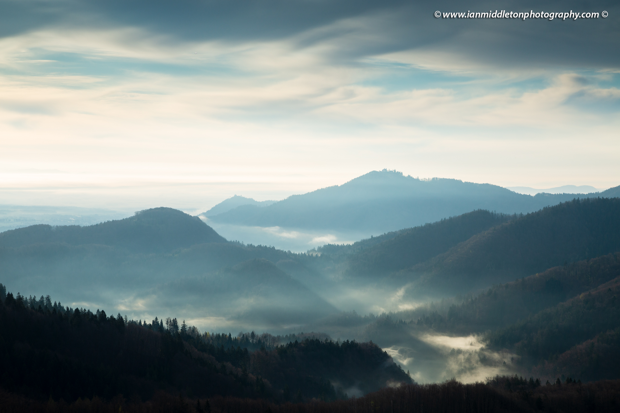 The hills around Jamnik on a spring morning and a view across to the church of Sv Jost above Kranj, Slovenia