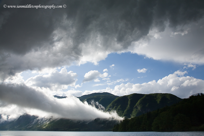Beautiful light and clouds scattering over Bohinj Lake after a massive storm blew over the Bohinj valley, Triglav National Park, Slovenia.