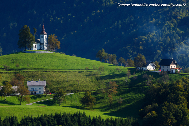View from Rantovš hill across to Sveti Tomaz nad Praprotnim (church of Saint Thomas) in the Skofja Loka hills, Slovenia.
