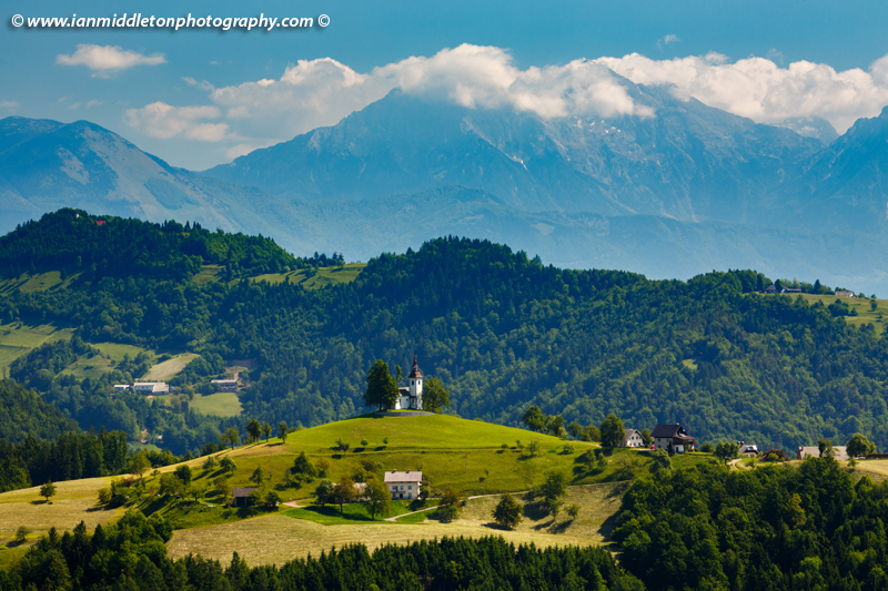 View across to Sveti Tomaz nad Praprotnim (church of Saint Thomas) in the Skofja Loka hills, Slovenia.
