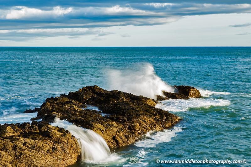 Waves crashing over rocks at Portlethen, near Aberdeen, Scotland.