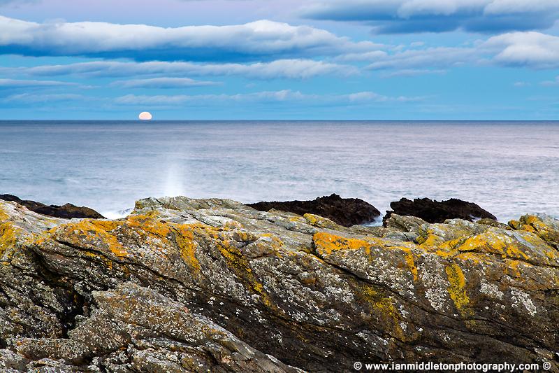 Moon rising after sunset at Portlethen, near Aberdeen, Scotland.