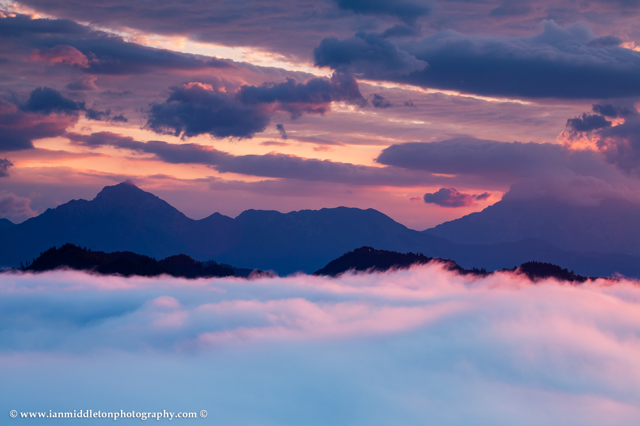 View across to Mount Storzic at sunrise from Rantovše hill near Skofja Loka, Slovenia.