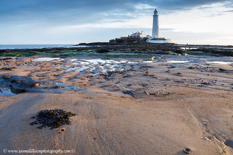 Saint Mary's Lighthouse on Saint Mary's Island, situated north of Whitley Bay, Tyne and Wear, North East England. Seen in the morning from the beach beside the causeway that runs out to the island. Whitley Bay is situated just north of Newcastle.