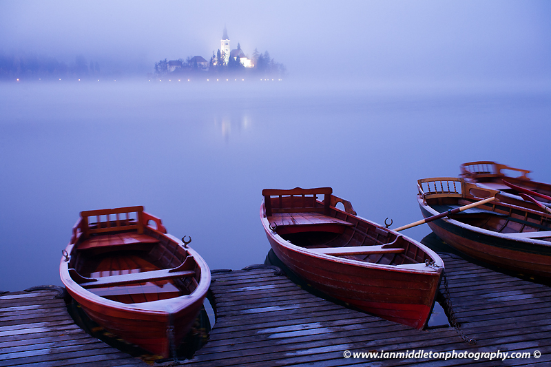 The famous Island church enshrouded in an icy mist and frost over Lake Bled.