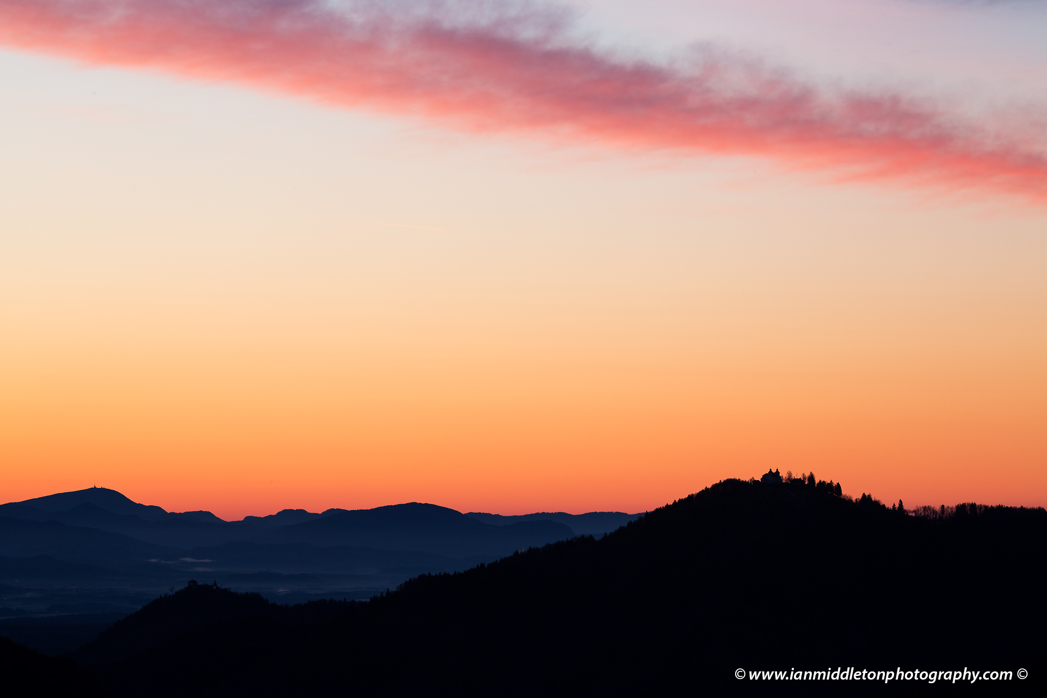 Sunrise view across to the church of Sv Jost above Kranj, Slovenia. Seen from Jamnik.