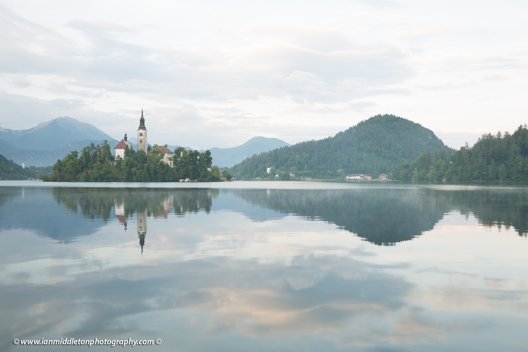 This image is exposed to the right. View across the beautiful Lake Bled, island church at sunset with the beautiful Karavank mountains in the background, Slovenia. Image has been deliberately overexposed in order to demonstrate the technique known as exposing to the right