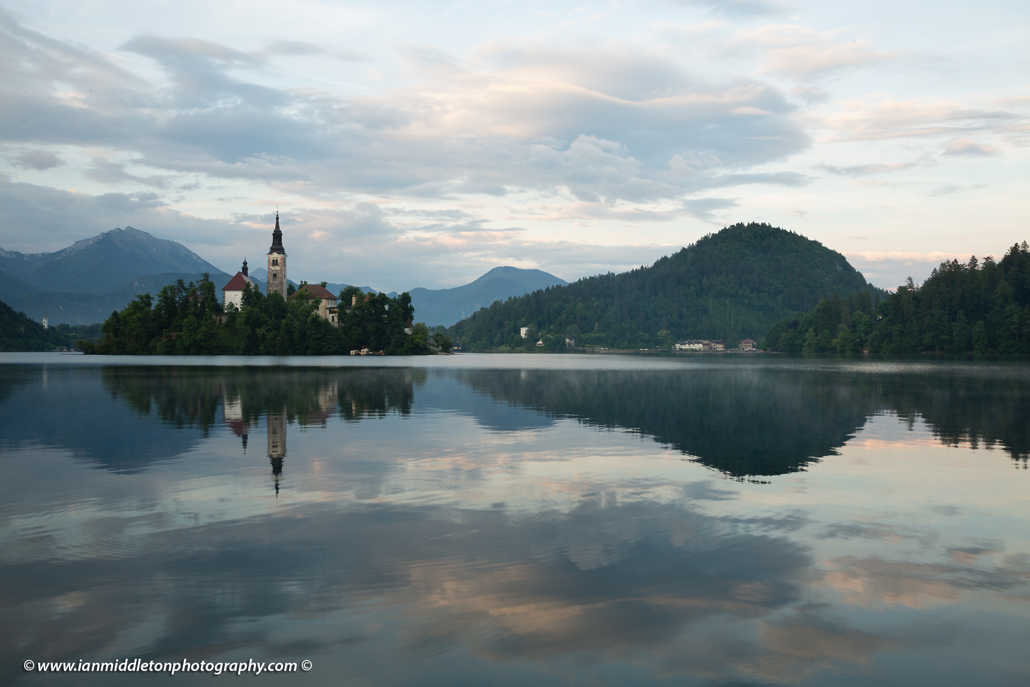 Normal exposure of this view across the beautiful Lake Bled, island church at sunset with the beautiful Karavank mountains in the background, Slovenia. Lake Bled is Slovenia's most popular tourist destination and the Karawanke mountains form the border between Slovenia and Austria.