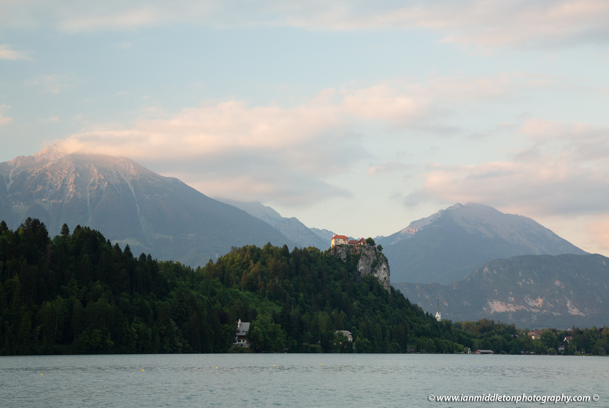 Beautiful light across the beautiful Lake Bled's hilltop castle and Mount Stol, the highest peak in the Karavank Mountains. Slovenia. - unedited version