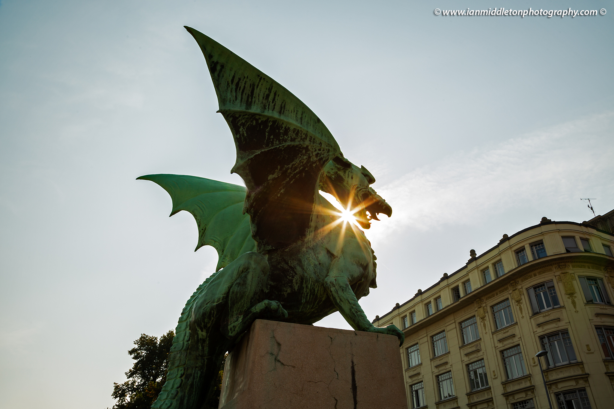 Sunburst through a dragon on the Dragon Bridge in Ljubljana, Slovenia.
