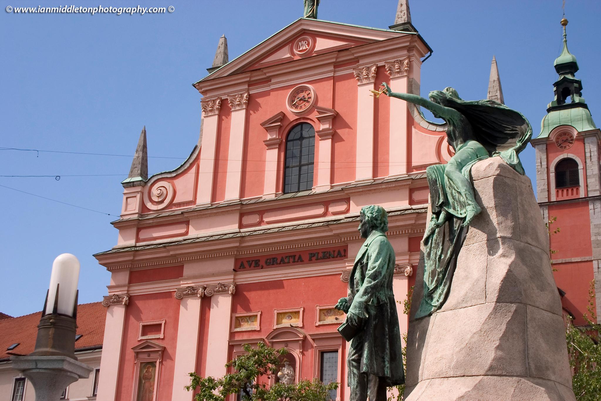 Preseren Square in Ljubljana, Slovenia. The beautiful Franciscan church and Preseren statue.