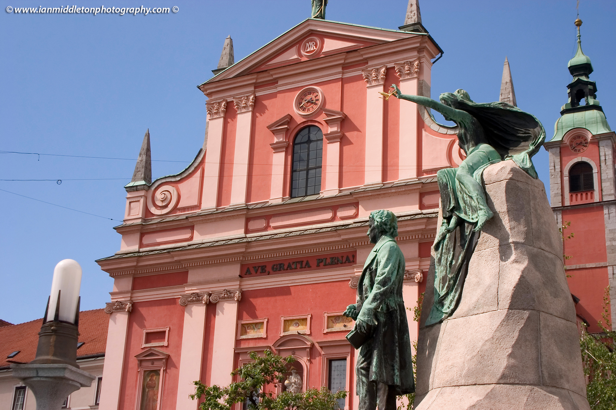 Preseren Square in Ljubljana, Slovenia. The beautiful Franciscan church and Preseren statue.