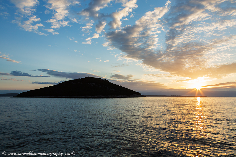Sunrise over the island of Veli Osir, near cunski, Losinj Island, Croatia.