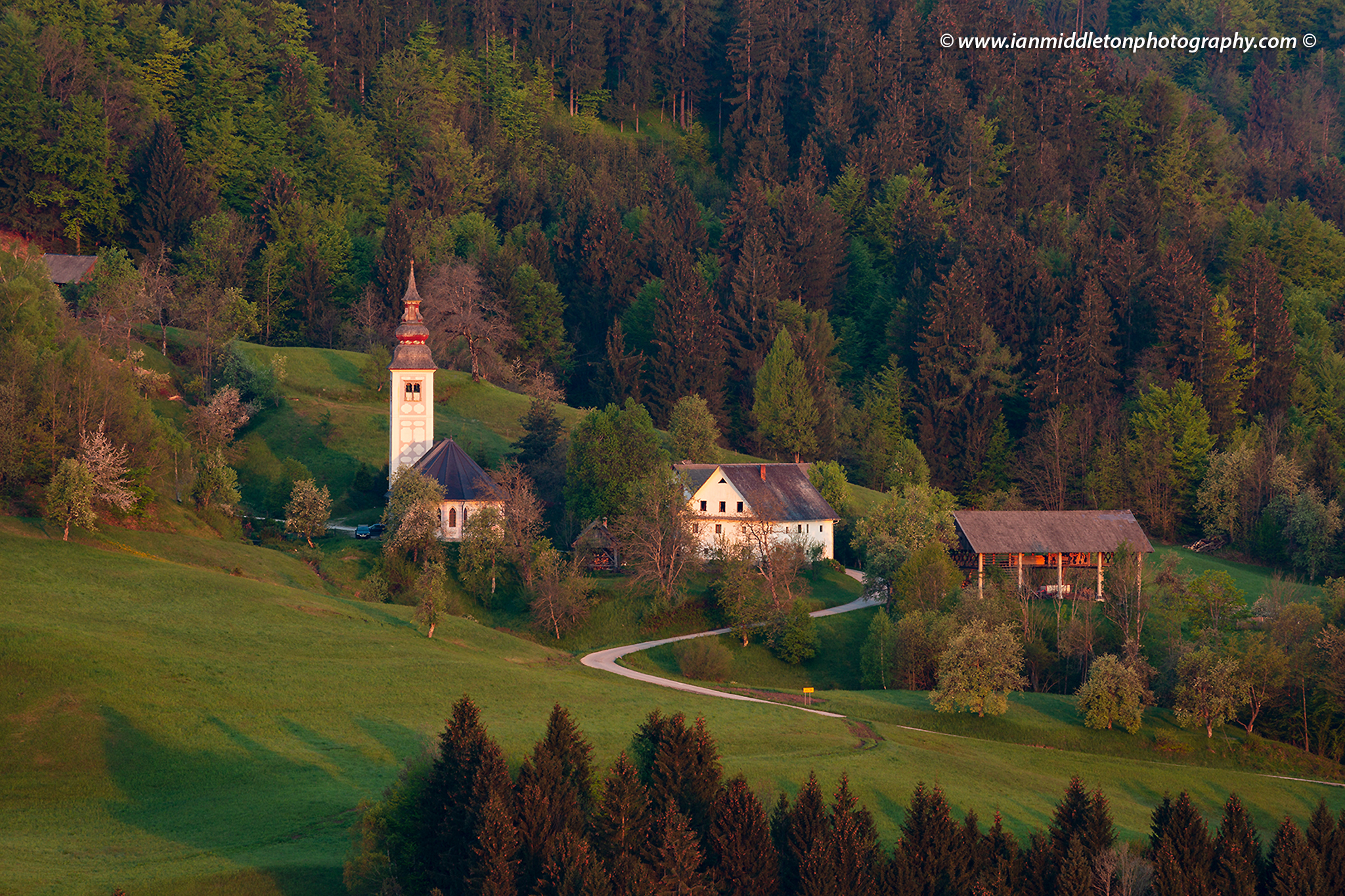 St Valentine church at Jarčje Brdo, seen from Rantovše hill, a small settlement in the Skofja Loka hills, Slovenia.