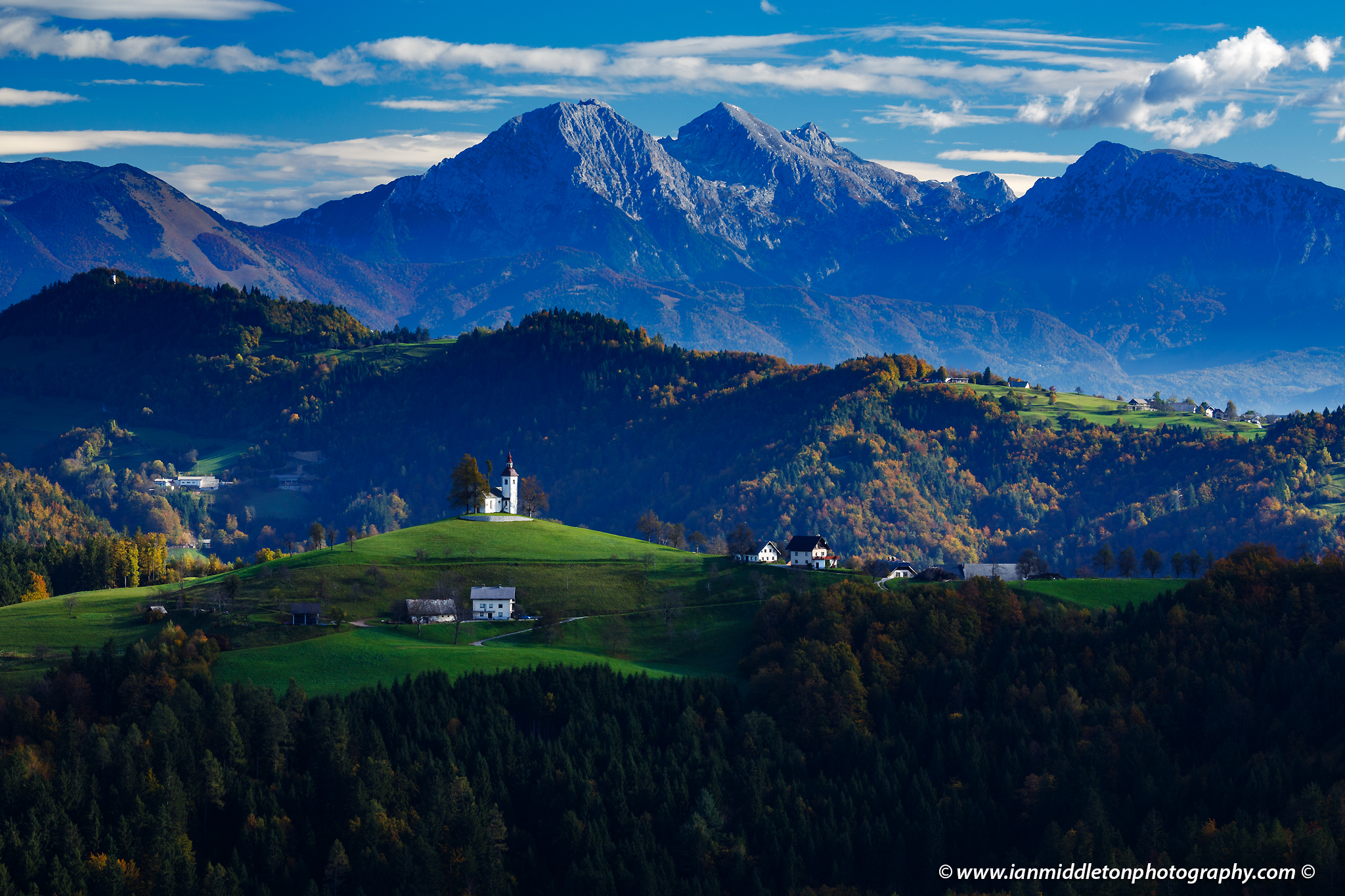 View from Rantovše hill across to Sveti Tomaz nad Praprotnim (church of Saint Thomas) in the Skofja Loka hills, Slovenia.