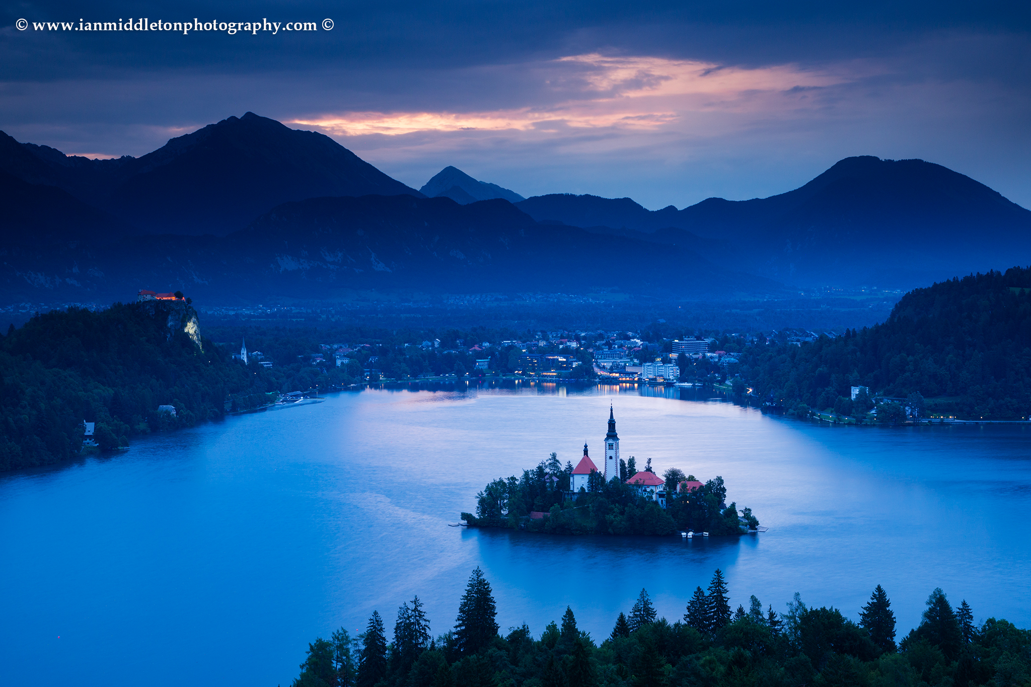 Early sunrise at Lake Bled. View across Lake Bled to the island church and clifftop castle from Ojstrica, Slovenia.