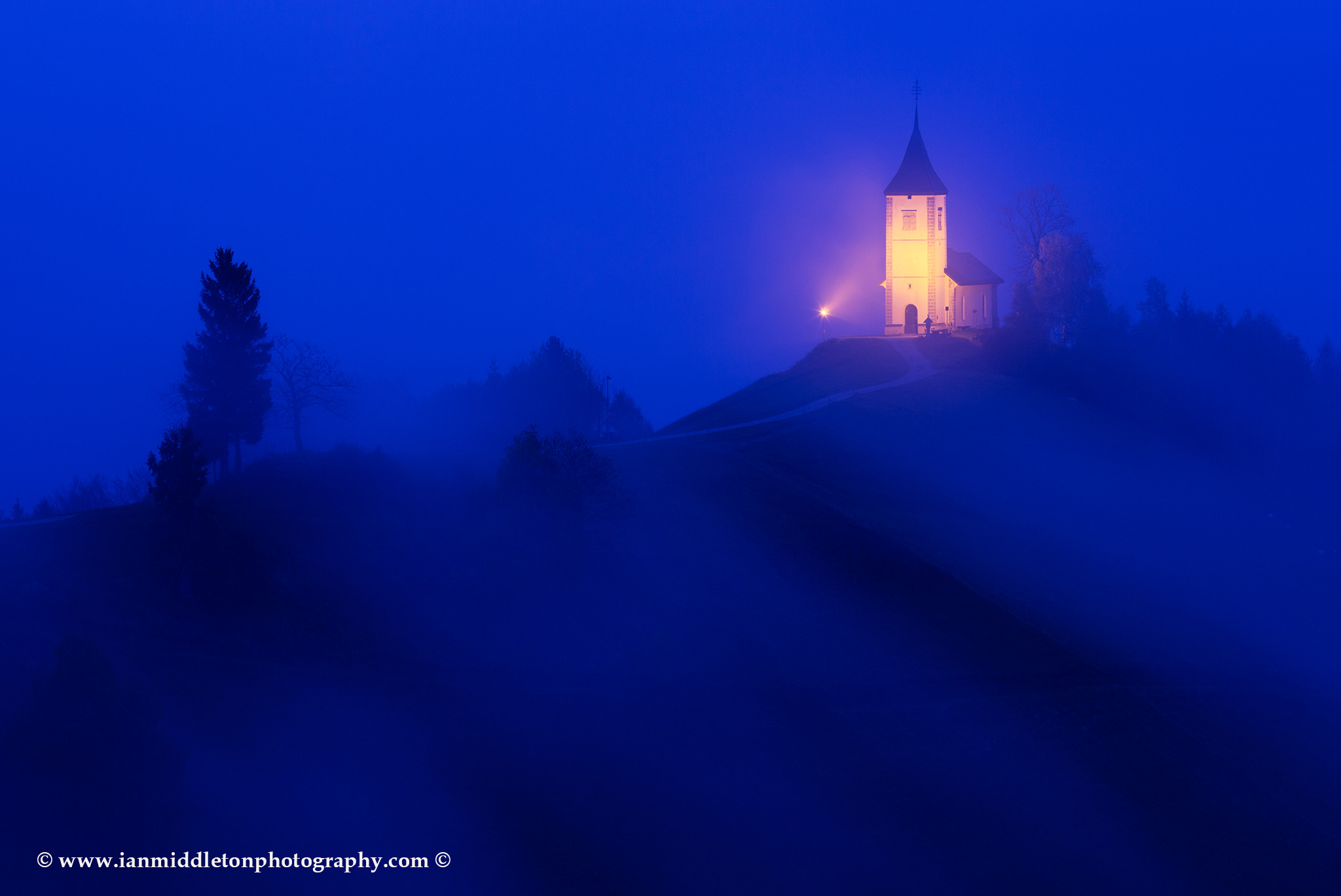 Jamnik church of Saints Primus and Felician at dawn, perched on a hill on the Jelovica Plateau, Slovenia.