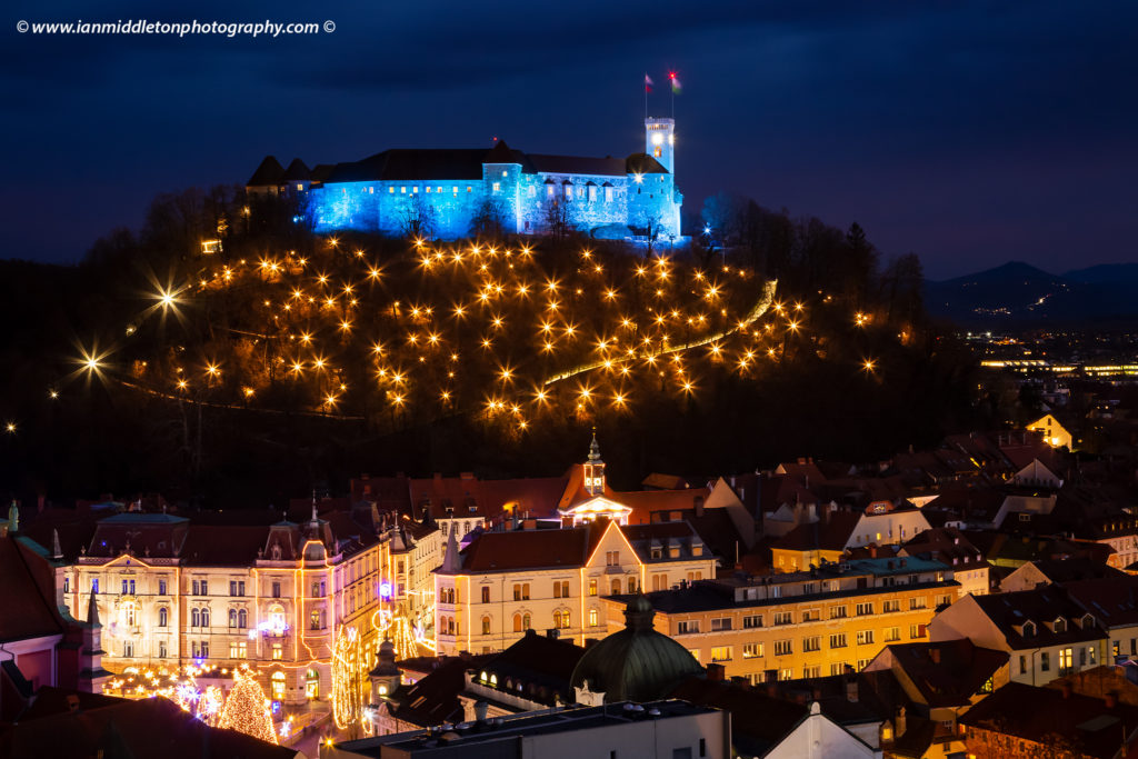 Christmas lights in Preseren Square with the the castle on the hill in Ljubljana, Slovenia. Seen from Neboticnik the Ljubljana castle and christmas lights are beautiful sight every Christmas.