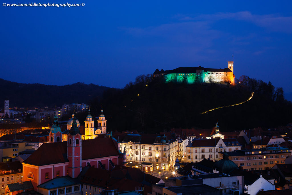 View down to the centre of Ljubljana and the Ljubljana Castle lit up in the colours of the Irish flag to celebrate Saint Patrick's Day weekend 2016 in Slovenia. The castle was lit up green last year to celebrate the event, but as Ljubljana is the European Green Capital for 2016 the castle is already being lit green at night for the whole year. So the Irish embassy arranged for the colours of the flag to adorn the castle for 2016.