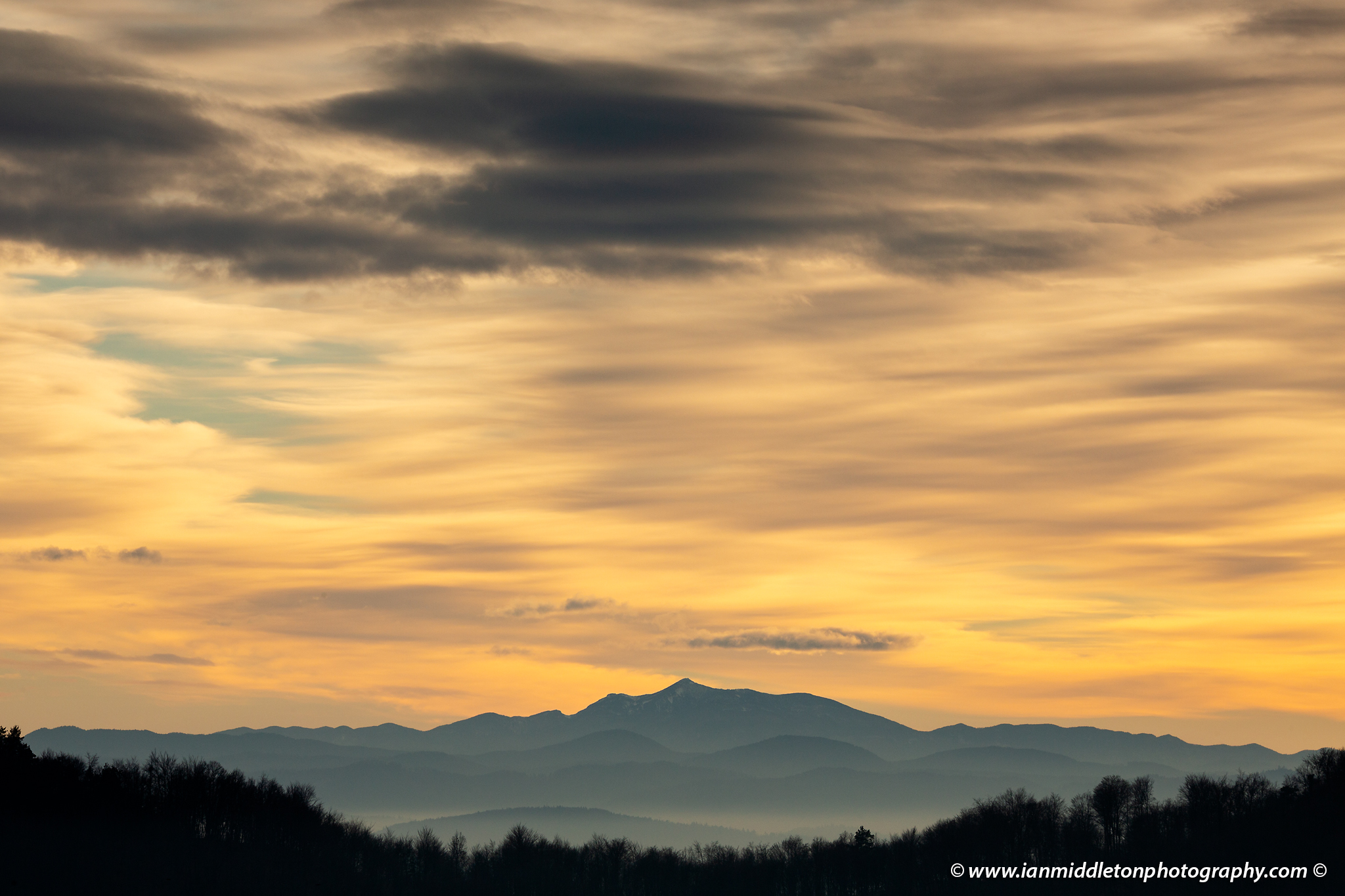 View across to the Sneznik mountain at sundown, seen from a hill in prezganje to the east of Ljubljana, Slovenia