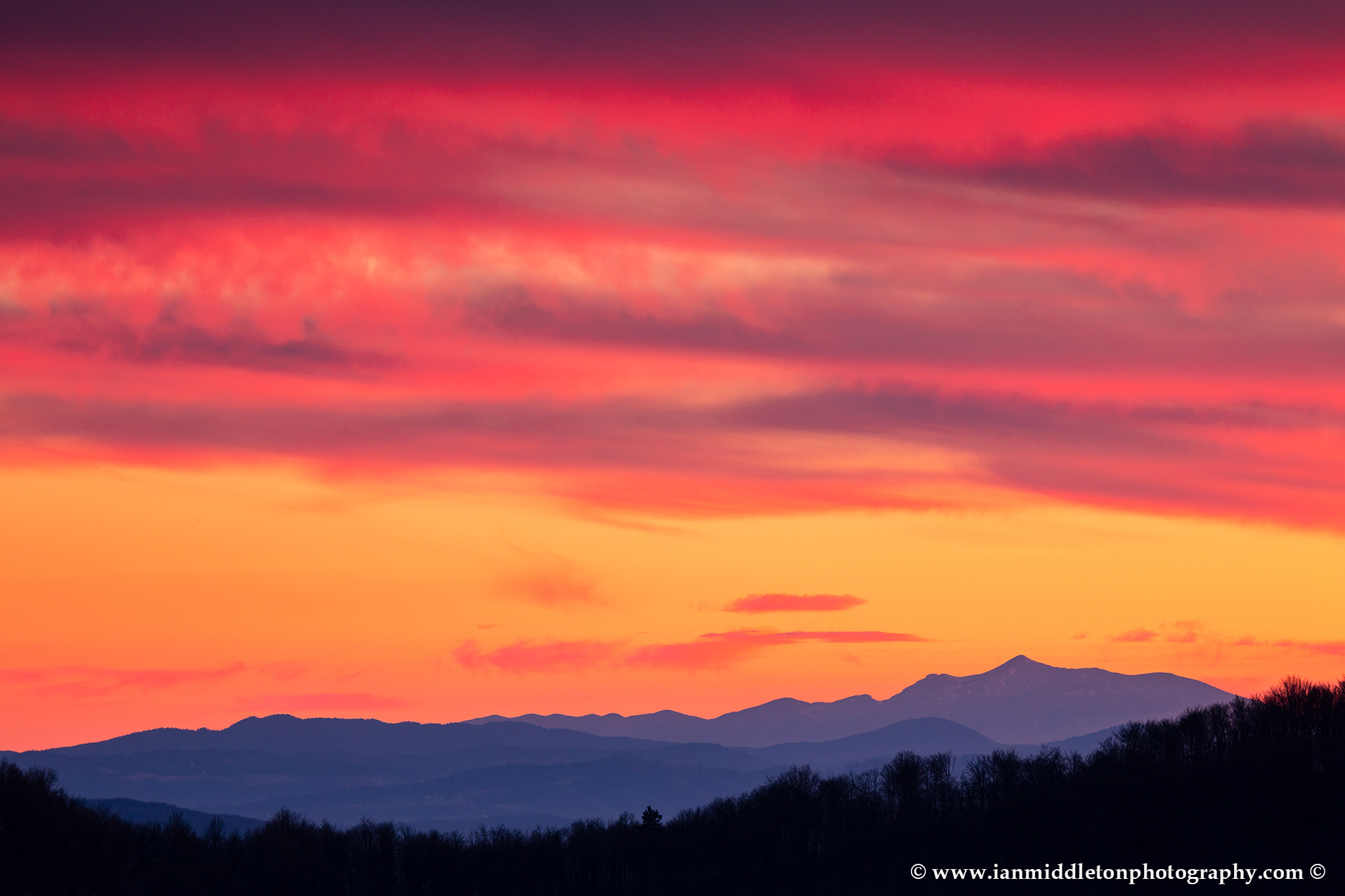 View across to the Sneznik mountain at sunset, seen from a hill in prezganje in the Jance hills to the east of Ljubljana, Slovenia