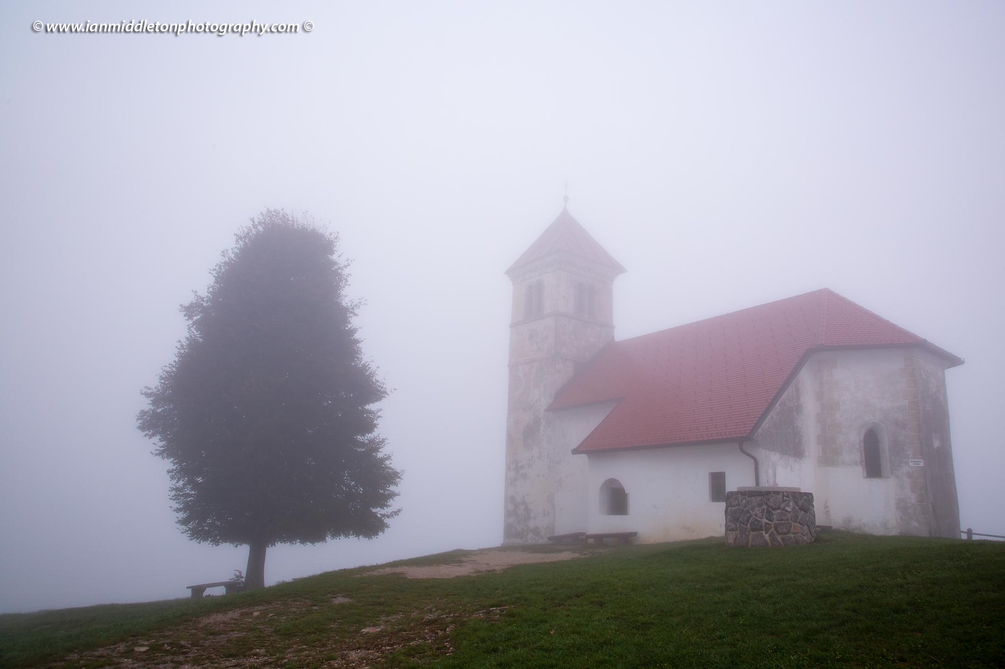The church of Saint Anna (Sveta Ana). Sveta Ana is perched upon an exposed hill overlooking the Ljubljansko Barje (Ljubljana moors) near the village of Preserje.