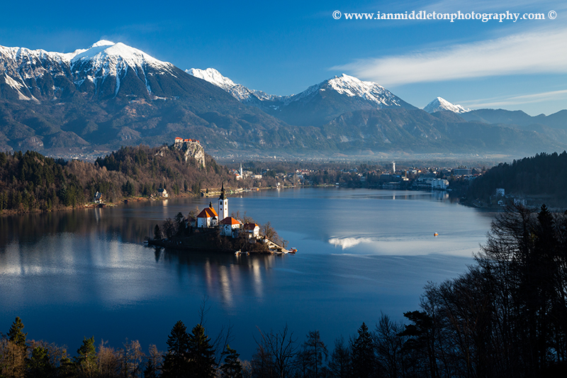 View across Lake Bled to the island church and clifftop castle from the trail up to Mala Osojnica, Slovenia.