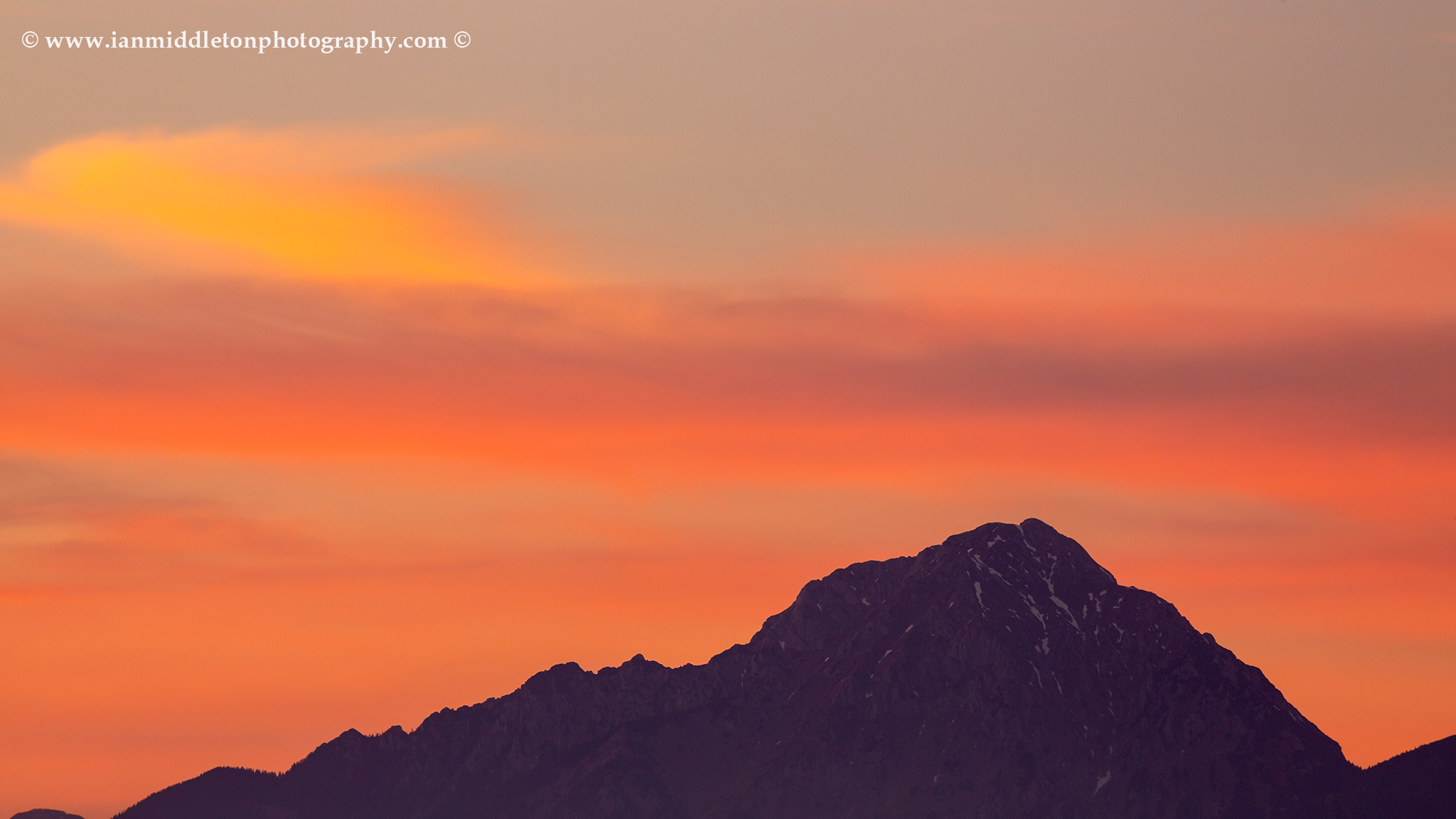 View of Storzic mountain, part of the Kamnik Alps, at sunset Slovenia.